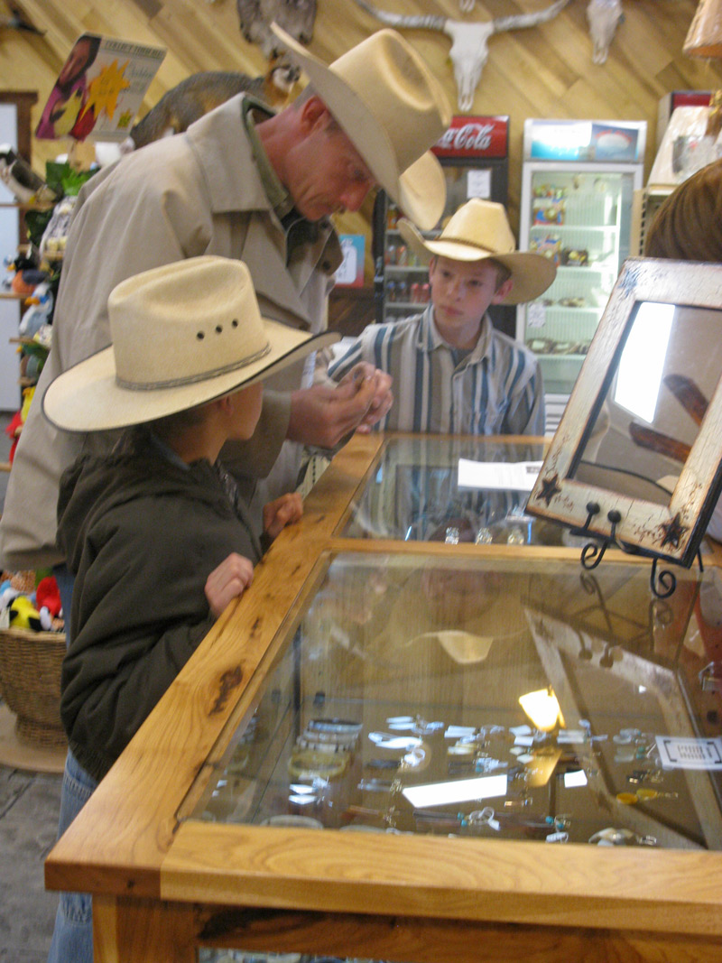 Father and sons view Texas Longhorn Jewelry - DY_0233