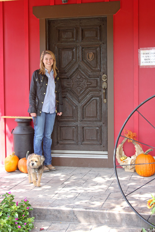 Woman with dog stands in front of new Store Mexican Hand Carved Door - Entry - Y_7623